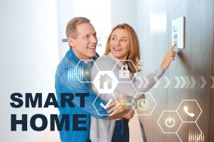 Young couple inputting information on smart home panel