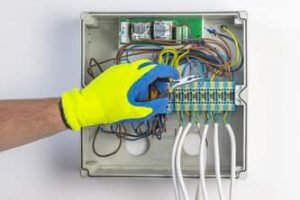 local Ajax electrician checking panel switch 2