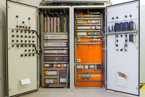 Electrical distribution box with wires, circuit breakers, and fuse box