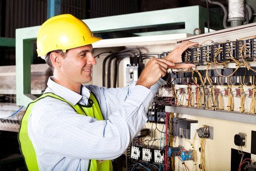 Ajax Electrical employee on Industrial job
