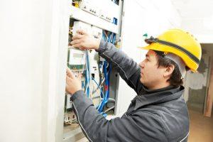 Ajax Electrical employee installing energy saving meter.