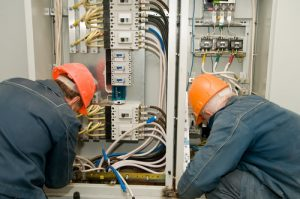 Ajax electricians fixing industrial circuit lines