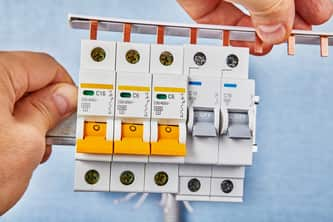 master electrician checking on panel switch