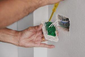Ajax electrician repairing a plug