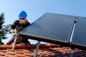 Ajax Electrical worker installing solar panels